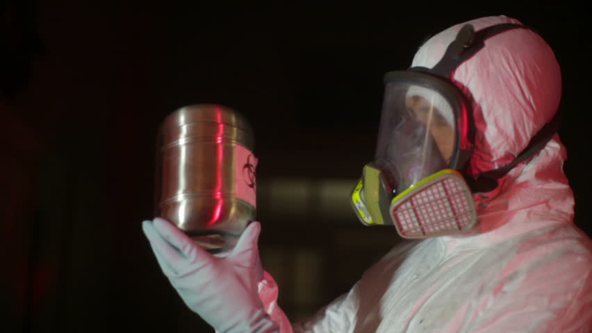 hazmat looking at a bio-hazard suit