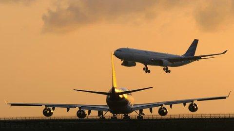 BALI, INDONESIA -  OCTOBER 15, 2017: Passenger air plane landing to airport runway during sunset