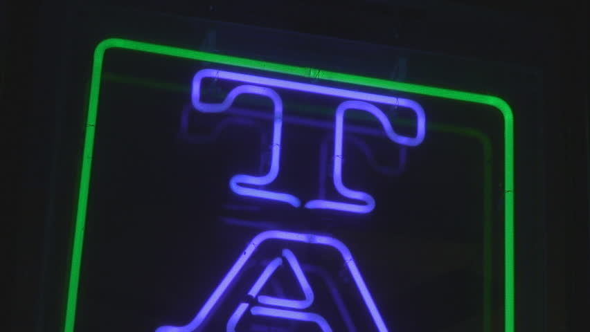 Tattoo neon sign at night - tilt