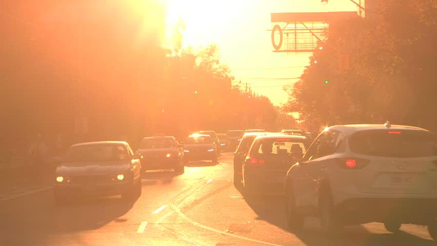 Toronto, Ontario, Canada October 2017 Fireball orange sunset blinding drivers and traffic on city street   Shutterstock HD Video #32105779