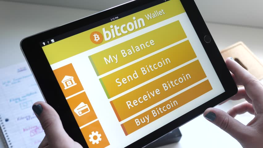 Montreal canada october 2017 buying bitcoin directly from a buying bitcoin directly from a tablet application converting the usd dollars into a digital currency ccuart Gallery