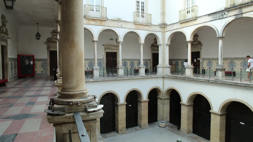 Coimbra, Portugal - August 14, 2017: cloister inside University of Coimbra, the Europe's oldest university founded in 1290. Unesco Heritage Site and most important tourist attraction in Coimbra.