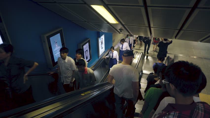 People standing on escalator going downwards into metro station - Bangkok, Thailand - September 2017 | Shutterstock HD Video #32186449