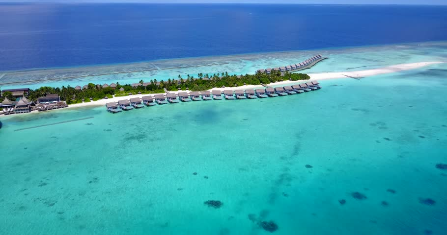 v09467 five 5 star resort water bungalows in Maldives with drone aerial flying view on white sand beach on tropical island