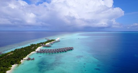 v09526 five 5 star resort water bungalows in Maldives with drone aerial flying view on white sand beach on tropical island
