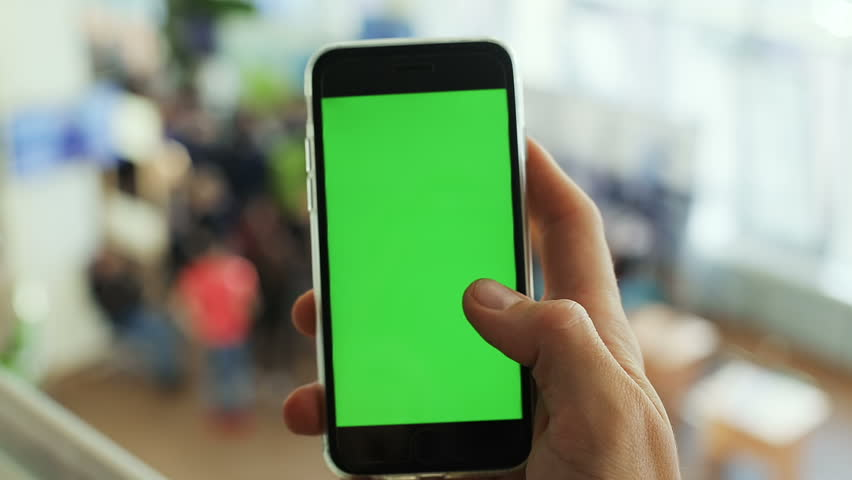 Closeup man hand using black smart phone mobile green screen chromakey display typing tapping texting message sms chatting communication online login website app pointing text touchscreen wifi chat | Shutterstock HD Video #32205619