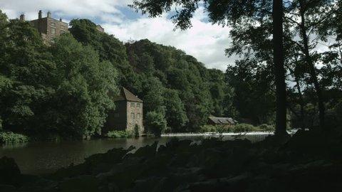 Durham, England, The River Wear at Prebends Bridge filmed downstream of the weir. 4K