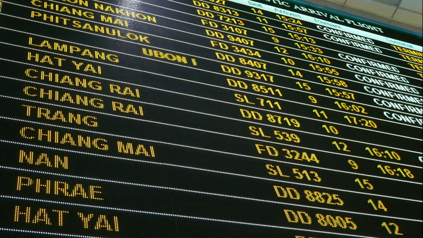 4K footage. LED digital airport flight information status board showing destination , airline flight number and flight status for departure and arrival at airport terminal. travel and transportation.