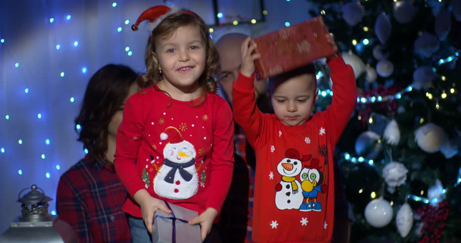 Beautiful family together at Christmas scene | Shutterstock HD Video #32244199