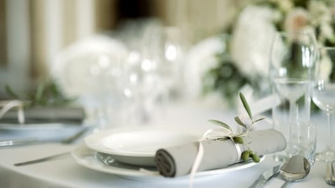 decorated table for a wedding dinner. Close up of elegant, decorated table prepared for a luxury dinner