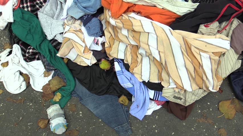 OLOMOUC, CZECH REPUBLIC, OCTOBER 20, 2017: Large mess of things containers secent hand to collect used clothing such as trousers, jackets, t-shirt leather, jackets and others, human vandalism, EU