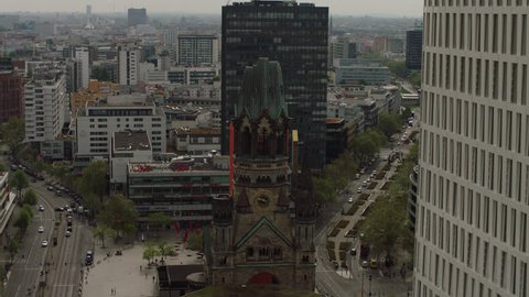 May, 2017 Berlin, Germany. Aerial ascent above looking down toward the Kaiser Wilhelm Memorial Church during the day.