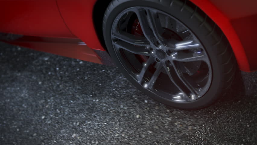 Alloy wheel of red sports car, driving on the road. Clip is loop-ready. | Shutterstock HD Video #3228763