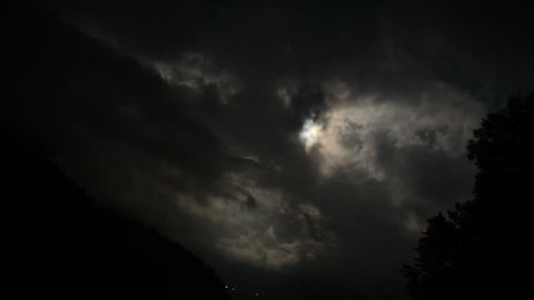 Time lapse of Moon Rolling Over Beautiful Clouds in Swiss Alps