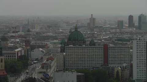 May, 2017 Berlin, Germany. Aerial tracking and zoom out on the Berliner Dome to a wide skyline featuring the TV Tower and Potsdamer Platz.
