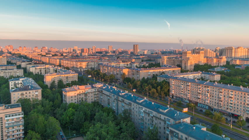 Moscow city bathed in yellow sun at dawn timelapse. Life in the stone jungle. An early foggy morning. Shadows moving on houses. Megalopolis aerial view from rooftop at Leninskiy avenue. The sky is | Shutterstock HD Video #32309239