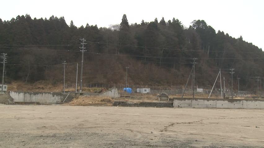 One year on, empty plots of land in town devastated by tsunami in Rikuzentakata, Japan.