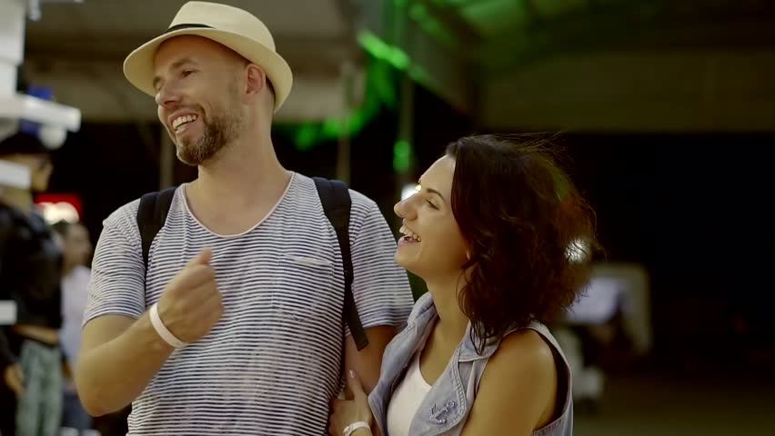 Young loving pairs is walking in shopping mall along shop windows, they are talking and laughing | Shutterstock HD Video #32323909
