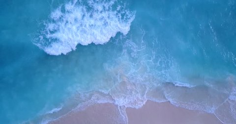 v12176 waves water texture breaking and crashing with drone aerial flying view of aqua blue and green clear sea ocean