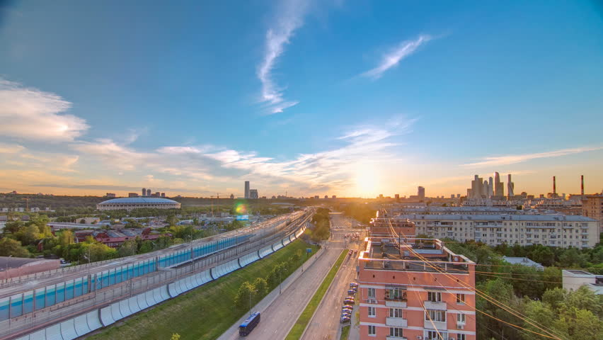 The Third Ring Road traffic at sunset timelapse aerial view from rooftop. Skyscrapers and stadium on background. The Third Ring is Moscow's newest beltway, located between the Garden Ring in the city | Shutterstock HD Video #32334859
