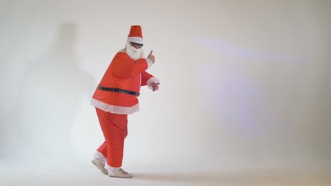Funny Santa Claus making funny dancing dance moves on a white background. 4K.