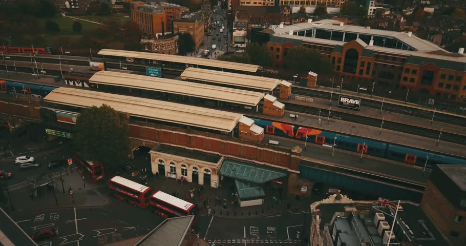 Aerial drone flight over Clapham Junction Station in London, England.  Good Cityscape for an establish shot, or clip about public transit.