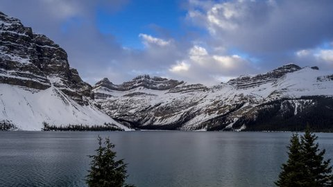 Time lapse of clouds blowing over a mountain peak along Bow Lake in Banff National Park.