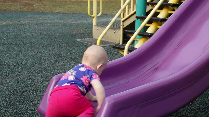 bd2958be8cb2f Baby Girl Climbing up Slide Stock Footage Video (100% Royalty-free ...