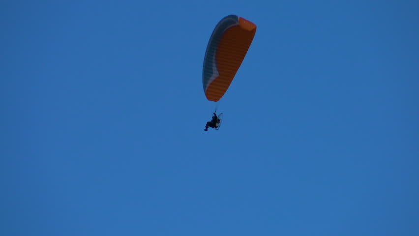 Paraglider with Motor Flies in Stock Footage Video (100% Royalty-free)  32399479 | Shutterstock