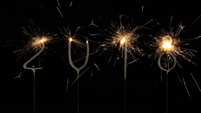 New Year's Eve celebration. 2018 made with sparklers on black background. Stop motion animation.