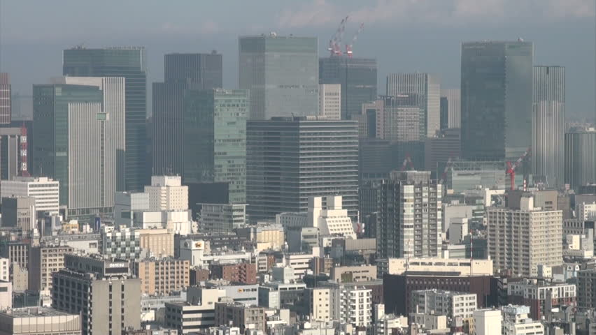 TOKYO, JAPAN - 7 NOVEMBER 2012: Financial district and Tokyo skyline in early sunlight | Shutterstock HD Video #3241519