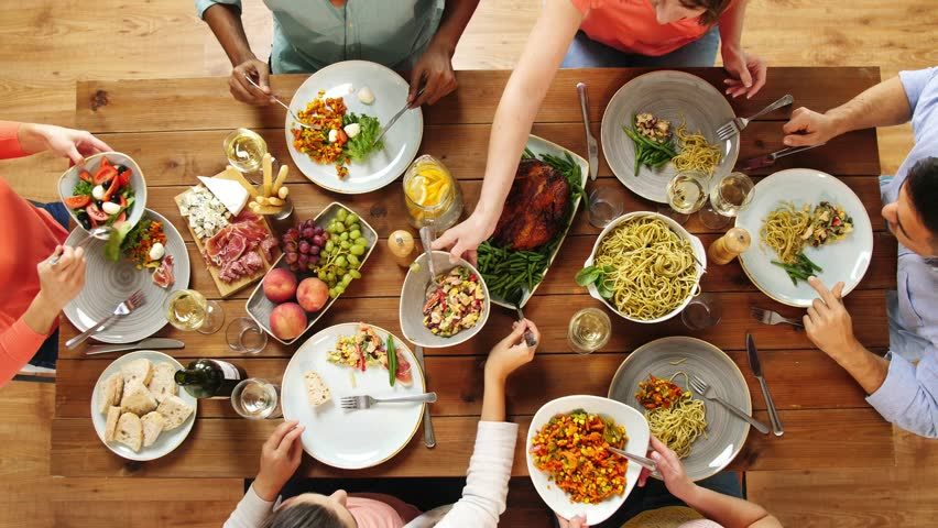 Eating and leisure concept - group of people having dinner at table with food | Shutterstock HD Video #32420266