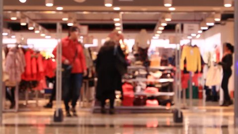Shopping in mall, walking people, blurred background. Time lapse.