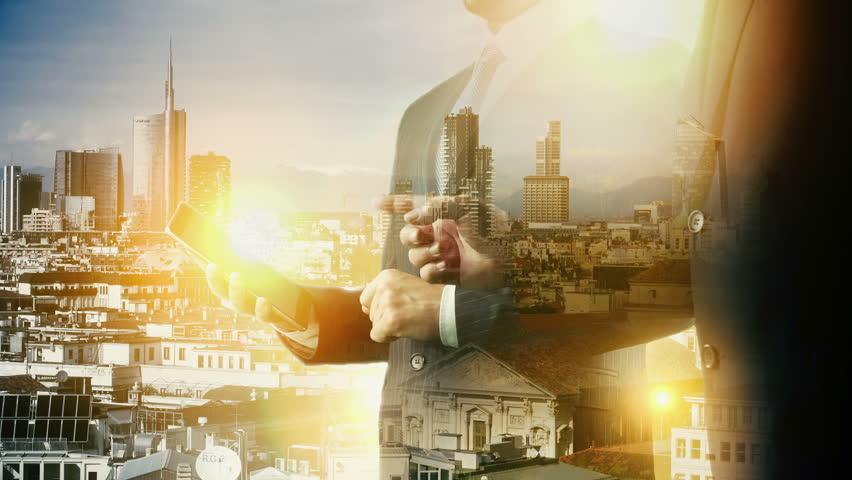 Milan Italy Cityscape Businessman digital tablet. Double exposure.   Shutterstock HD Video #32440693