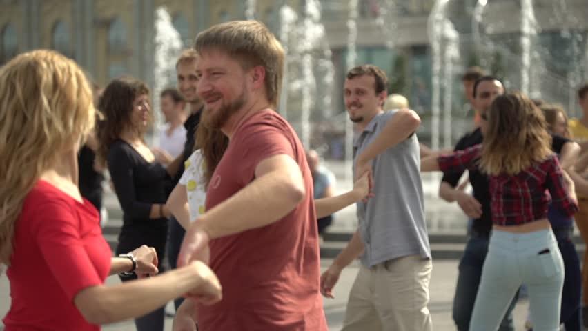 KYIV, UKRAINE - SEPTEMBER 26, 2017. Latin dance. People dance in the street. Slow motion