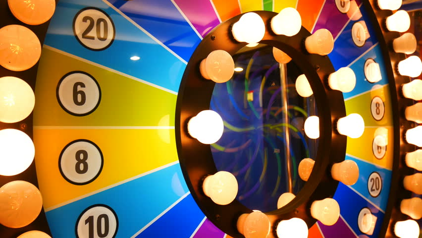 4K footage loop. retro colorful casino game cabinet flashing lights. game spinning light with bankrupt, success and fresh start slots. slot machine gamble footage background