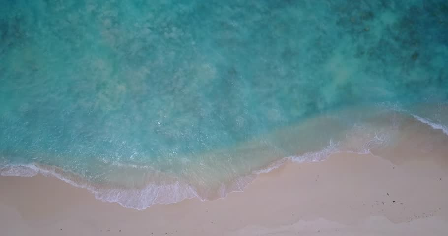 V14067 waves water texture breaking and crashing with drone aerial flying view of aqua blue and green clear sea ocean   Shutterstock HD Video #32485219
