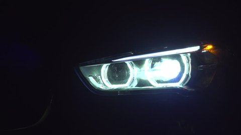 A car headlight turning on and off
