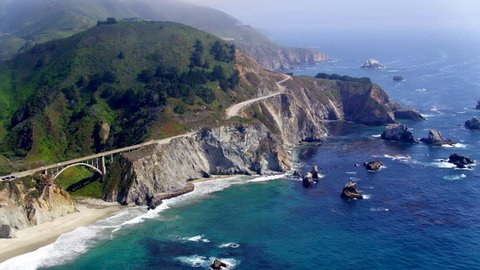 Aerial Drone Stock Video of Big Sur rocky Coastline with Bridge