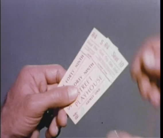 Close-up of male hands tearing ticket stubs