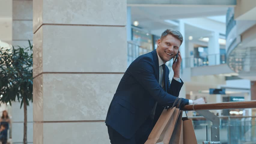 Young businessman with a shopping bag | Shutterstock HD Video #32584849