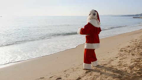 Christmas Vacation - Santa Claus is having fun and dancing on the beach