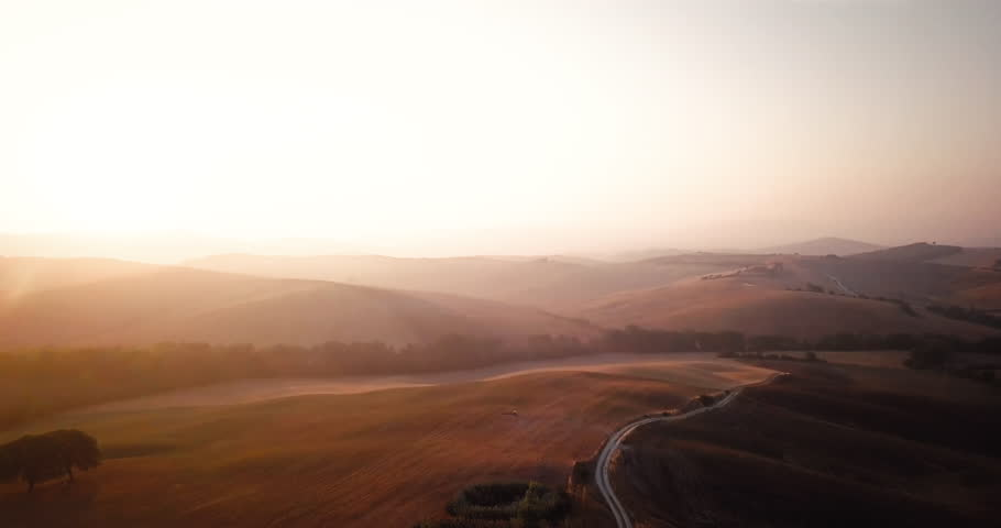 Helicopter Camera Flaying Above The High Way And Capturing - Tranquil photos capture the beauty of tuscanys countryside
