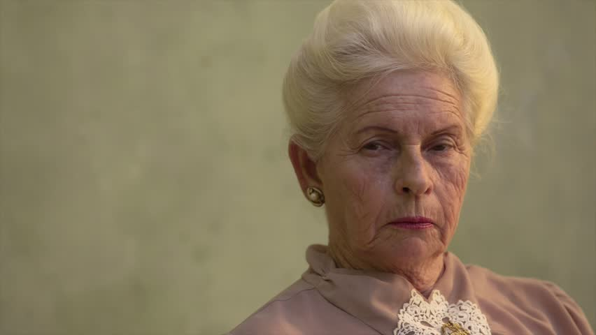 Elderly women and feelings, portrait of serious senior caucasian woman looking at camera. Sequence