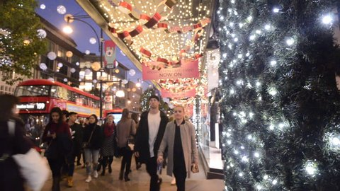 LONDON- NOVEMBER, 2017: Oxford Street, London's busiest retail street with 2017 christmas lights and many people shopping at night