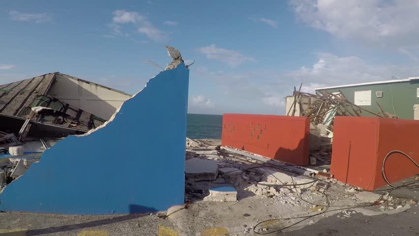 San Juan, Puerto Rico - October 03, 2017: Hurricane damage on Caribbean oceanfront houses in La Perla, Puerto Rico