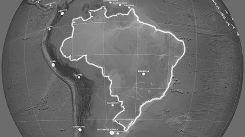 Zoom-in on Brazil outlined on the globe. Capitals, administrative borders and graticule. Elevation & bathymetry - grayscale