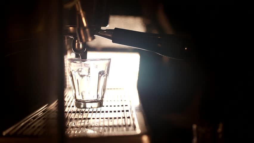 coffee espresso shot by streaming machine in coffee cafeteria bar. Brewing Process concept. coffee blending process. footage for background, wallpaper animation
