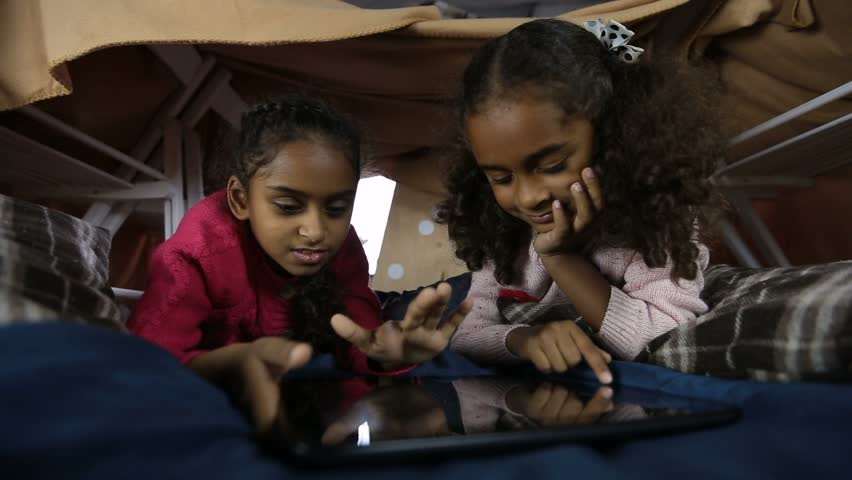 Excited girls playing online games on touchpad | Shutterstock HD Video #32689669