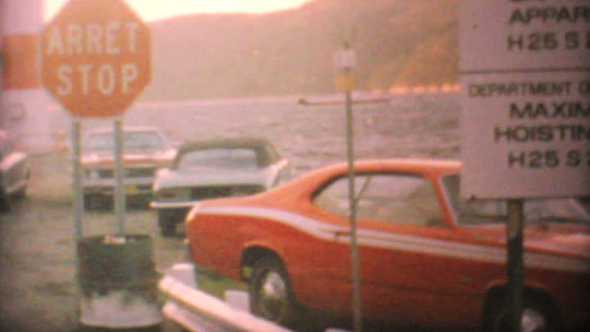 Cars wait to board a ferry to various islands in northern Canada en route to do some hunting in 1969.